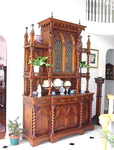 """Entry Foyer - French carved walnut Gothic style Buffet A Deux Corps with stained glass door panels, circa late 19th century. The initials """"DS"""" carved into the shields of the figures near the top suggest that it was custom built."""