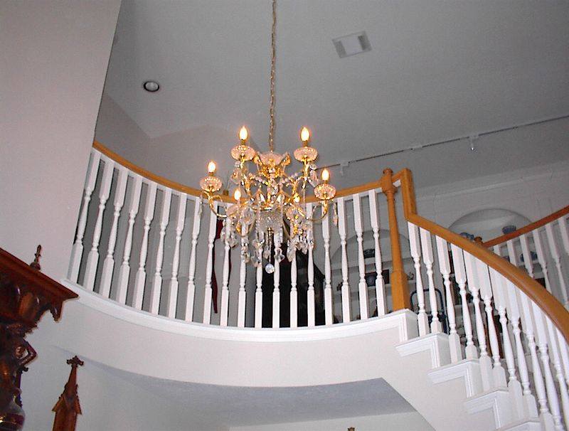 Entry foyer - Gold plated six light Spanish chanelier draped with Strass crystal