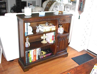 """Definitely not an antique, but it was so right for the spot that we bought it at an """"antique"""" auciton for $135. It's an English piece, circa 1960's or later, designed in the gothic tradition. Henry VIII in the alcove feels right at home here."""