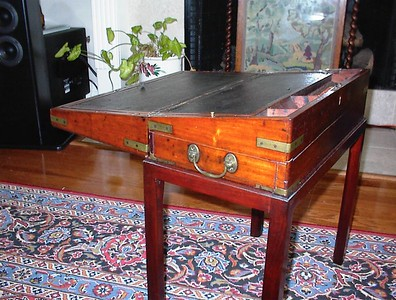 Family room - 19th century mahogany campaign style lap desk on stand (not original to the piece), shown in the fully open position.