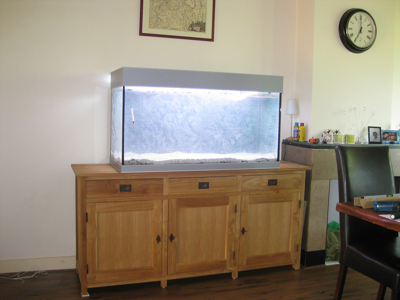 Aquarium filled and lights on with lids on