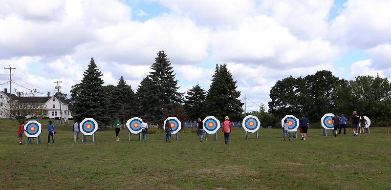 On Site Archery (owner Bob Wait of Billerica), holds classes Saturday mornings at Vietnam Veterans Park in Billerica. Students retrieve their arrows.  (SUN/Julia Malakie)