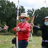 "On Site Archery (owner Bob Wait of Billerica), holds classes Saturday mornings at Vietnam Veterans Park in Billerica. Leslie Whiteing , center, and her daughter Leann Cowan, right, both of North Billerica, get fitted with bows at their first session in the adult class, with help from Wendy Seymour of Billerica, who first got involved with archery to help teach her daughter's Girls Scout troop. Asked what prompted them to try archery, Whiteing said jokingly, ""we're preparing for the  Apocalypse. We want to be like Katniss.""  (SUN/Julia Malakie)"