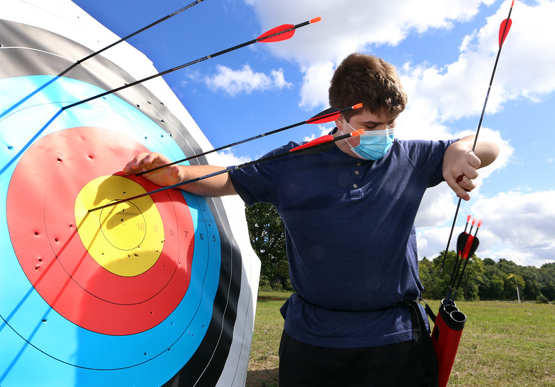 On Site Archery (owner Bob Wait of Billerica), holds classes Saturday mornings at Vietnam Veterans Park in Billerica.  Ben Evangelista, 17, of Westford, retrieves his arrows. (SUN/Julia Malakie)