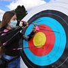On Site Archery (owner Bob Wait of Billerica), holds classes Saturday mornings at Vietnam Veterans Park in Billerica. Emma Seymour, 12, of Billerica, retrieves her arrows. [Per Bob Wait, Seymour is third in her age group at the Indoor Nationals.]  (SUN/Julia Malakie)