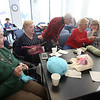 Knitting group at the Billerica Senior Center knits and crochets hats, gloves, scarfs, baby afghans, chemo caps and other items for veterans, kids, babies, and cancer patients. From left, Dolores Buonomo, Louise Hale, Loretta Gay, Bess Clarke and Liz Antoszewski, all of Billerica. (SUN/Julia Malakie)