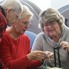 Knitting group at the Billerica Senior Center. From left, Loretta Gay and Bess Clarke help newer knitter Liz Antoszewski figure out how to correct a mistake. All are from Billerica. (SUN/Julia Malakie)
