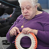 Knitting group at the Billerica Senior Center. Pat Daly of Billerica uses a loom to knit a hat. (SUN/Julia Malakie)