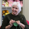 Knitting group at the Billerica Senior Center. Elaine Williams of Billerica crochets a chemo cap. (SUN/Julia Malakie)