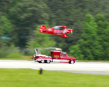 Jet Truck passing a plane