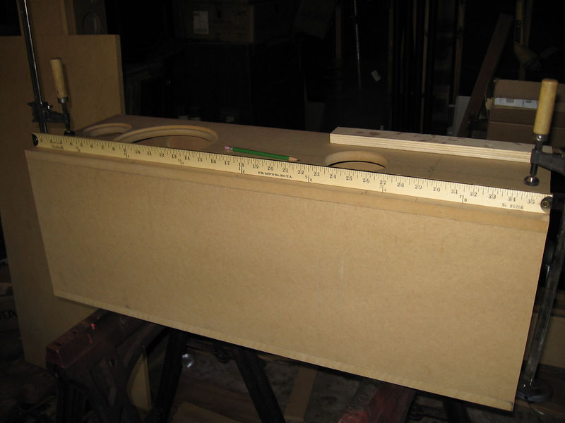 """Here's one enclosure set up on sawhorses for a test fit. The braces inside each side panel add to the stability of the unglued enclsoure during this step. Use the yardstick to make pencil marks along both edges of the front panel at the following distances from the top: 2"""" 10"""", 18"""", 26"""", and 34"""". These marks indicate the location of the 1-1/2"""" #4d finishing nails you will use to align and secure the panels. (OK, I'll admit it - I recessed the drivers because I have a router and it' easy to do, but it isn't necessary)."""