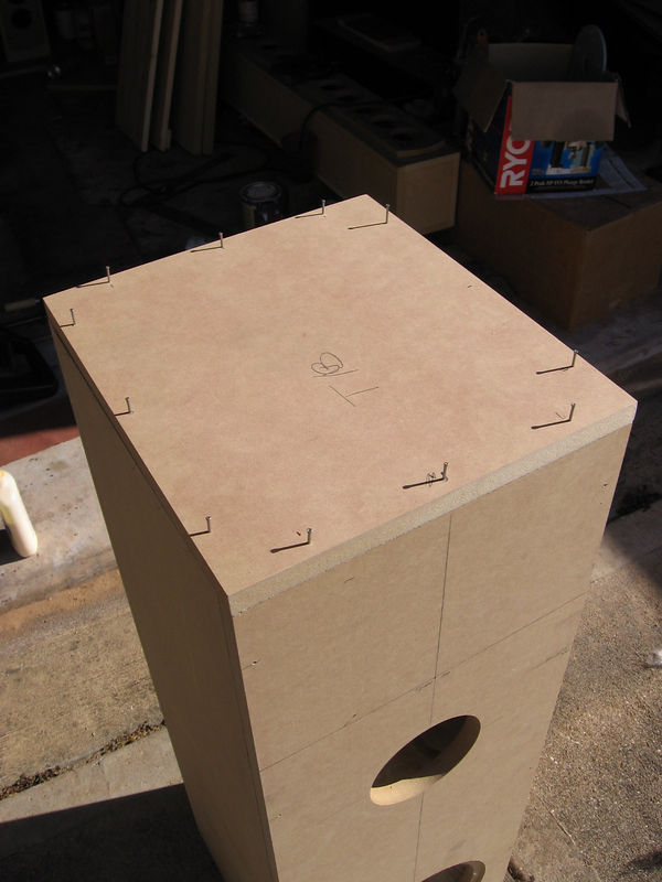 Then you attach the bottom and the top panels using the same technique you did with the front and side panels.