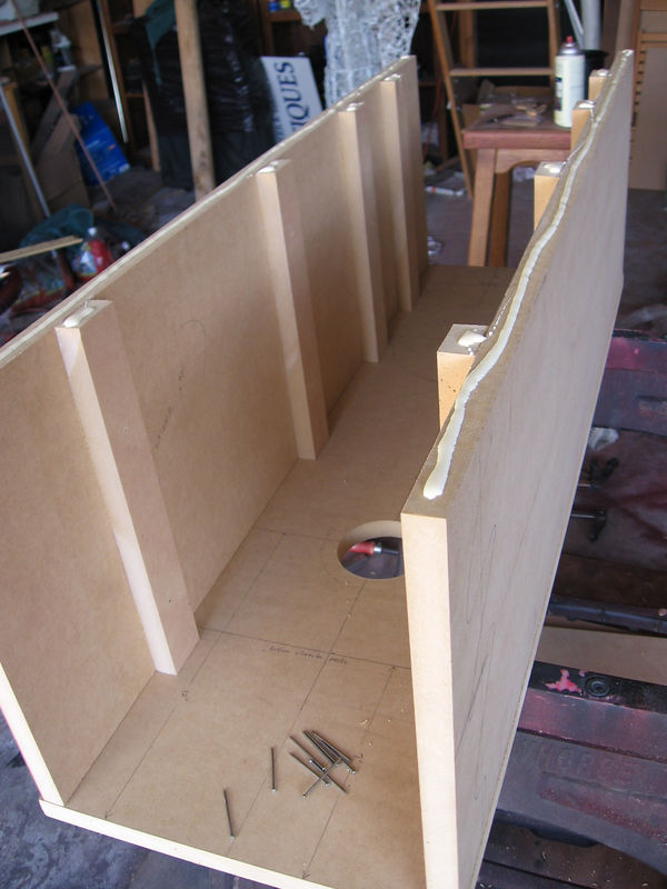 Apply a generous bead of carpenters glue along the top of the side panels as shown.