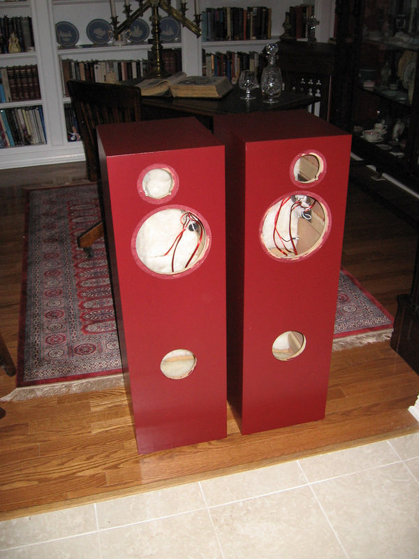 """The painted speakers waiting for driver reinstallation. The EZ way to paint speakers is to roll it on. I prefer Rustoleum American Accents paint. It's available in a quart size can which is adequate for a pair of speakers. Using a smooth 4"""" long roller, apply three or four coats about a half hour apart. This vinyl based paint drys quickly, but it remains a bit tacky for a month or more, so don't place any heavy objects on the speakers for a couple of months or they will mar the finish."""