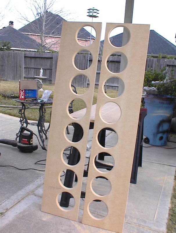 """The completed braces with a chamfer (45 degree angle) cut into the circumference of each hole to reduce internal reflections. The solid section of each brace will form the back panel for a separate chamber behind the array of eight tweeters. Thesse braces are placed about 6"""" behind the front baffle with the holes aligned with the drivers."""