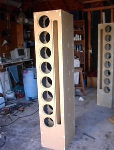 The finishing begins by filling the screw holes with wood putty. This is an especially important step in the process if the enclosure is to be painted. The putty shrinks while drying and a second application and sanding will be necessary to make the holes completely invisible. Paint, especially if it's dark and/or glossy, is even less forgiving of little mistakes than a woman who has caught her man in bed with her best friend.