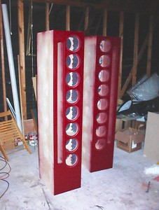 The front baffles are painted, so it's time to buy the cherry veneer for the sides. (That red looks good on a small speaker, but after seeing it on these large enclosures I changed my mind and painted them black).