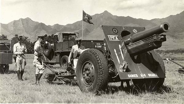 Original C. 1936 photograph depicting United States Army officers of the 11th Field Artillery inspecting a cannon.<br /> Hawaii