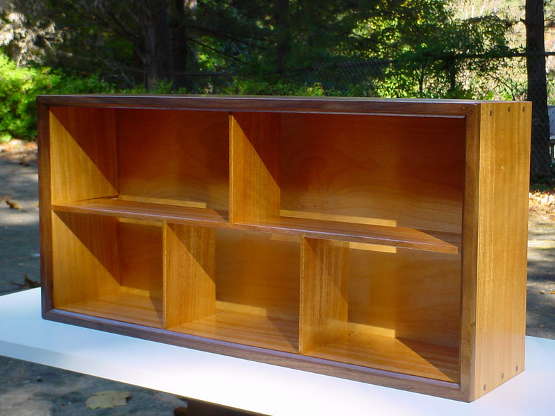 "Mahogany CD case w/ walnut accents - 1/4"" shelve & vertical splits - put together w/ rabbets & Miller walnut dowels - holds just over 100 CDs."