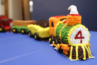 "Elijah's Train Cake - almond pound cake cars with buttercream frosting, pretzel rod logs, oreo cookie crumb ""coal"""