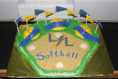 Legacy High School 2010 Softball Banquet - Ballfield half chocolate cake and half white cake; softballs - 2 white cake, 1 chocolate cake.  Bases, ribbons, pennants and blue lettering are edible fondant.