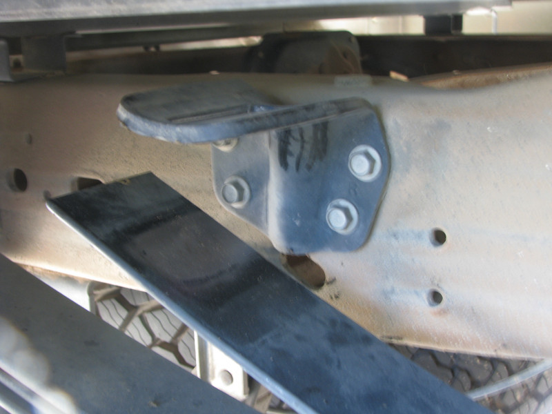 Placement of the overload extension required compressing the over spring down wards, this was accompanied by using a pry bar on all four over load extensions.
