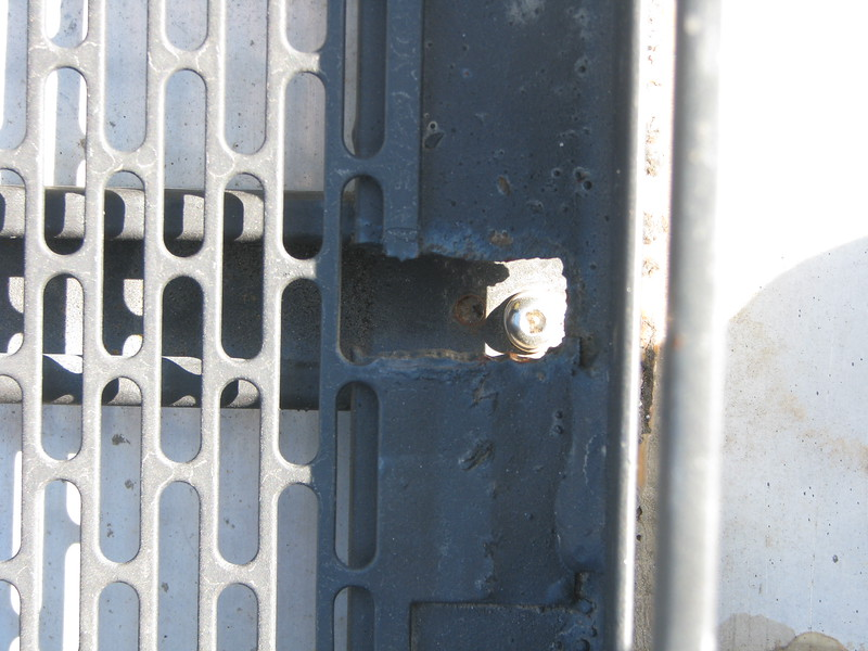 Slots were cut into the rack frame to allow access to the retaining bolts.