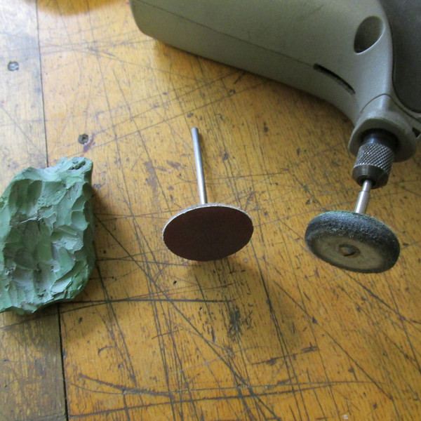 Tools for shaping and grinding most shapes or curves on steel blades. The center disk is a flexible disk with a male Velcro receiver attached, this provides quick exchange of various grit Velcro backed sandpaper. I cannot over emphasize the need to polish (mirror finish) the cutting or knife edge tools. That's what the felt wheel and green buffing compound are for.