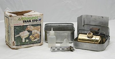 Stansport Trail Stove (Optimus 99 clone)<br /> <br /> I found this little gem of a stove at a local junk store.  It is an obvious clone of the Optimus 99 - Made in Taiwan.  It came complete with it's box (minus one end flap), a pan holder, spirit bottle, funnel, and combo key tool.  I did very little cleaning, and it fired up first try. The main differences between this and an Optimus that I found - no indentations on the end of the tank - Optimus apparently used the same tanks in their 8R series stoves.  Also, look for the triangle Stansport logo - the logo can be seen on the rubber portion of the key, and sometimes on the aluminum case.