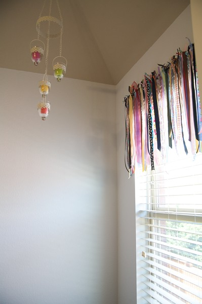 Another fun shot of the ribbon valance and candle mobile.  Lots of empty wall space for hanging future projects.  I'll begin decorating with my own creations very soon.  I'm sure I won't have trouble filling up my space.