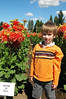 "Chandler in front of a huge flower! It's 10"" accross."