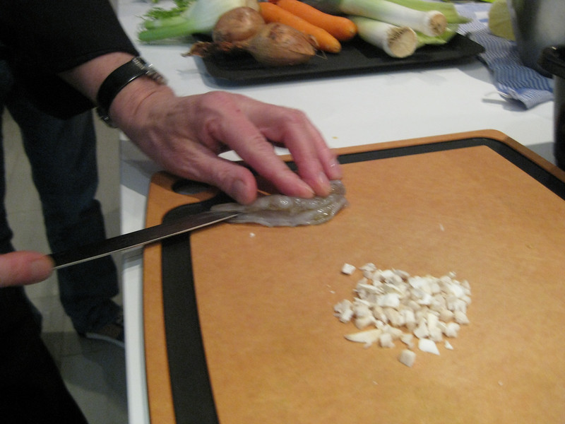 Cutting a white shrimp for use with our shrimp carpaccio