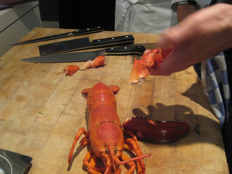 Cutting a lobster: break off the claws