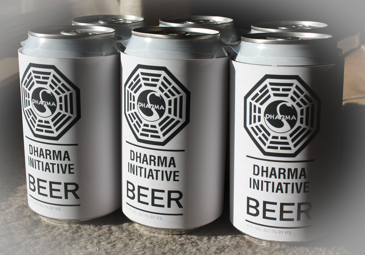Used spray-on adhesive to mount labels to cans.