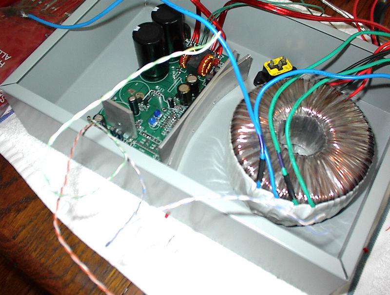 DIY heat sinks, make from Home Depot aluminum strips, shown in the under construction AMP5 100 watt/ch Tripath digital amp.