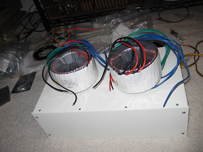Twin 1kVA isolation transformers sitting atop the case they will be mounted in to provide balanced power to the system.
