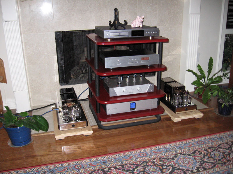 The current downstairs system includes a Belkin power filter, Audio Experience Music II tube-retified preamp, Lite Audio DAC-60, Onix XCD-88 CD player used as a transoprt, and Audio Mirror 40 watt parallel 6C33C SET monoblock amps.