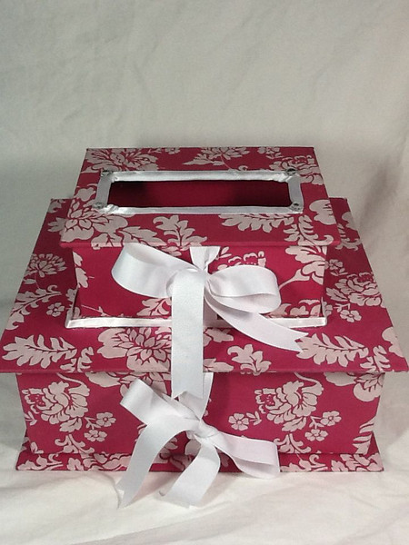 """This is a double layered card box.  It is two pink and white boxes stacked upon each other.  They are kept closed by white gingham ribbons on each box.  With these same closures, you can open both boxes.  The two boxes in total are measuring at an 8 ½"""" height.  The small box on top is measuring at 8 1/8"""" x 6 2/8"""" x 3 2/8"""".  The larger bottom box is measuring at 12 1/8"""" x 10 2/8"""" x 4 ½"""".  As I mentioned, this box was not completed in time for my friend's shower so it is brand new.  It has merely been kept in the closet. I am asking $10 for the card box."""