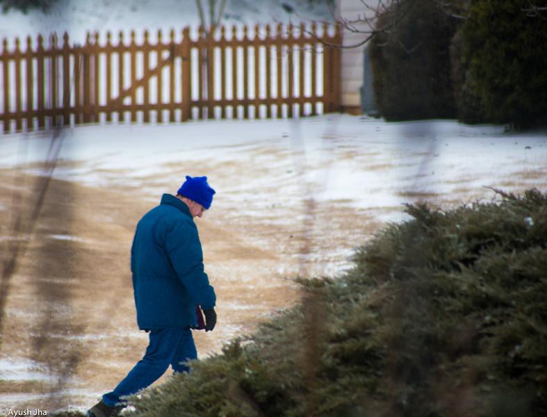 A stranger walking in winter storm