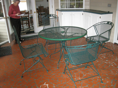Patio or porch furniture  Green painted metal.  One table and eight chairs. Also octagonal low table.