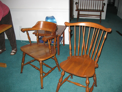 Two Windsor chairs and one Captains's chair