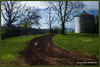 "Finished version.     Farm in Pigeon Forge, Tenn.....Sky was originally channel masked, then darkened slightly.  The foreground was copied to a new layer, with the layer mode changed to ""soft light.""  Then a curves layer was added that overly lightened the foreground, but hidden with a black layer mask.  Then selected areas where painted back in on the layer mask with a white brush."