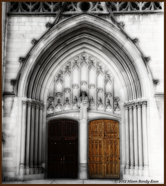 "Finished photo of the front doors from Church on North Meridian St. in Indianapolis.  This was my favorite of the Saturday I spent playing around with these photos.  I increased the contrast of the original photo slightly with a curves layer, then took the image into Photo Effects where I added to filter layers.  The first was one of my favorites, the ""Deep Forrest"" filter, then the top layer was the ""Dawn Treader"" black/white filter.  After coming back into PS, the doors were masked out to allow the increased contrast doors to show through.  Finally, the layer opacity was reduced to about 90%"
