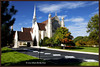 "Church on North Meridian St. in Indianapolis.  The mask was CTRL-clicked to create a selection of the foreground.  This was put on a separate layer by hitting CTRL-J while the selection was active.  The resulting layer was taken into Perfect Effects and the ""Deep Forrest"" filter was used.  After coming back into Photoshop, the layer opacity was lowered slightly."