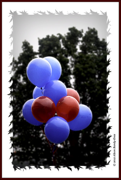 Colors were enhanced slightly in Lab color space.  After going back into RGB, the back ground was duplicated.  The blue channel of the background layer was used to develop a mask for the balloons and added as a layer mask to the blurred layer.