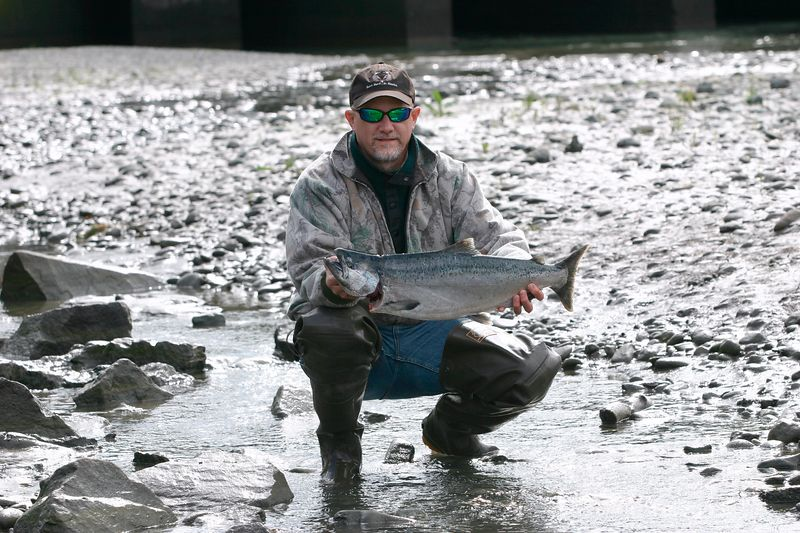 Visiting from Pennsylvania, my brother Steve catches his first king salmon.