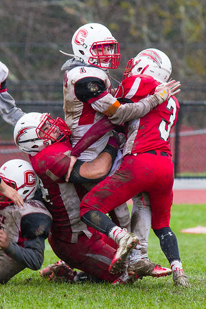 Carson Meczywor (3) and Austin Rahilly (74) wrap up Ken Ortiz (1) in the second half Saturday.