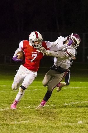 Zeke Locklear (7) attempts to get around the tackle of Antonio Govan Jr.