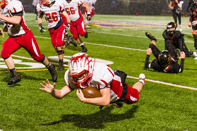 Liam Feeley dives for a few extra yards after eluding a number of WIldcat players.