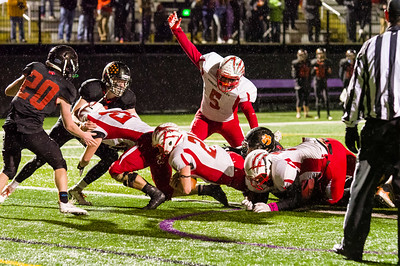 Liam Feeley scores the go-ahead two-point conversion in OT Friday night.